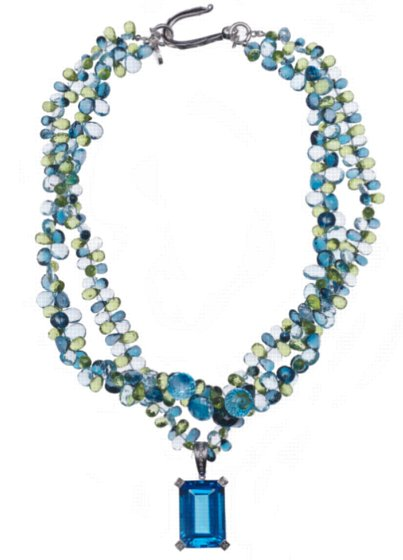 100 Carat Blue Topaz Pendant in white gold with diamonds on multi-strand necklace
